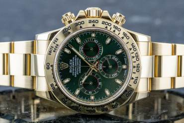 "pre owned ROLEX Cosmograph DAYTONA Chronometer ""green dial"" in Yellowgold"