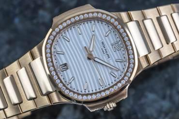 pre owned PATEK PHILIPPE NAUTILUS with Diamond Bezel - 56 Diamonds approx. 0.707 Carat