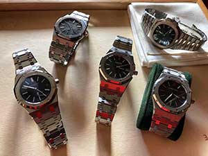 Several used Audemars Piguet watches on a table